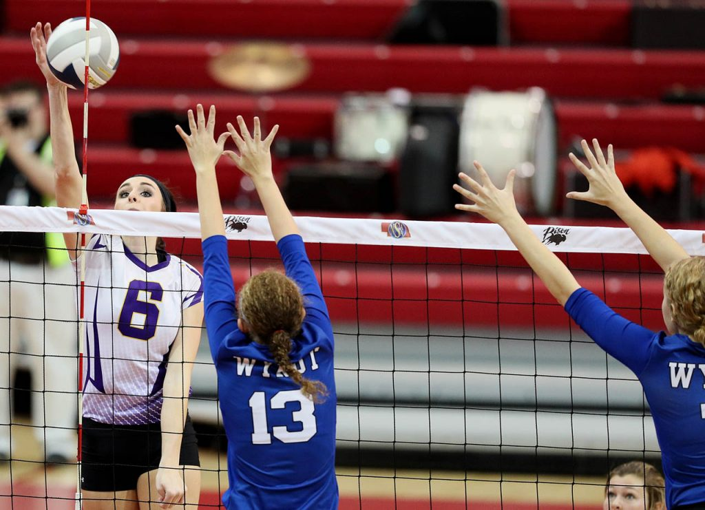 Hampton senior Madison Van Housen (6) peers over the net while getting a kill against WYNOT during the Class D2 2016 NSAA State Volleyball Championship at the Devaney Sports Center.