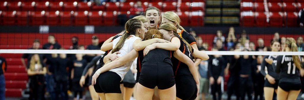 Stanton senior Sally Brechbill yells while huddled with her teammates celebrating a point against Diller-Odell during the Class C2 2016 NSAA State Volleyball Championship.