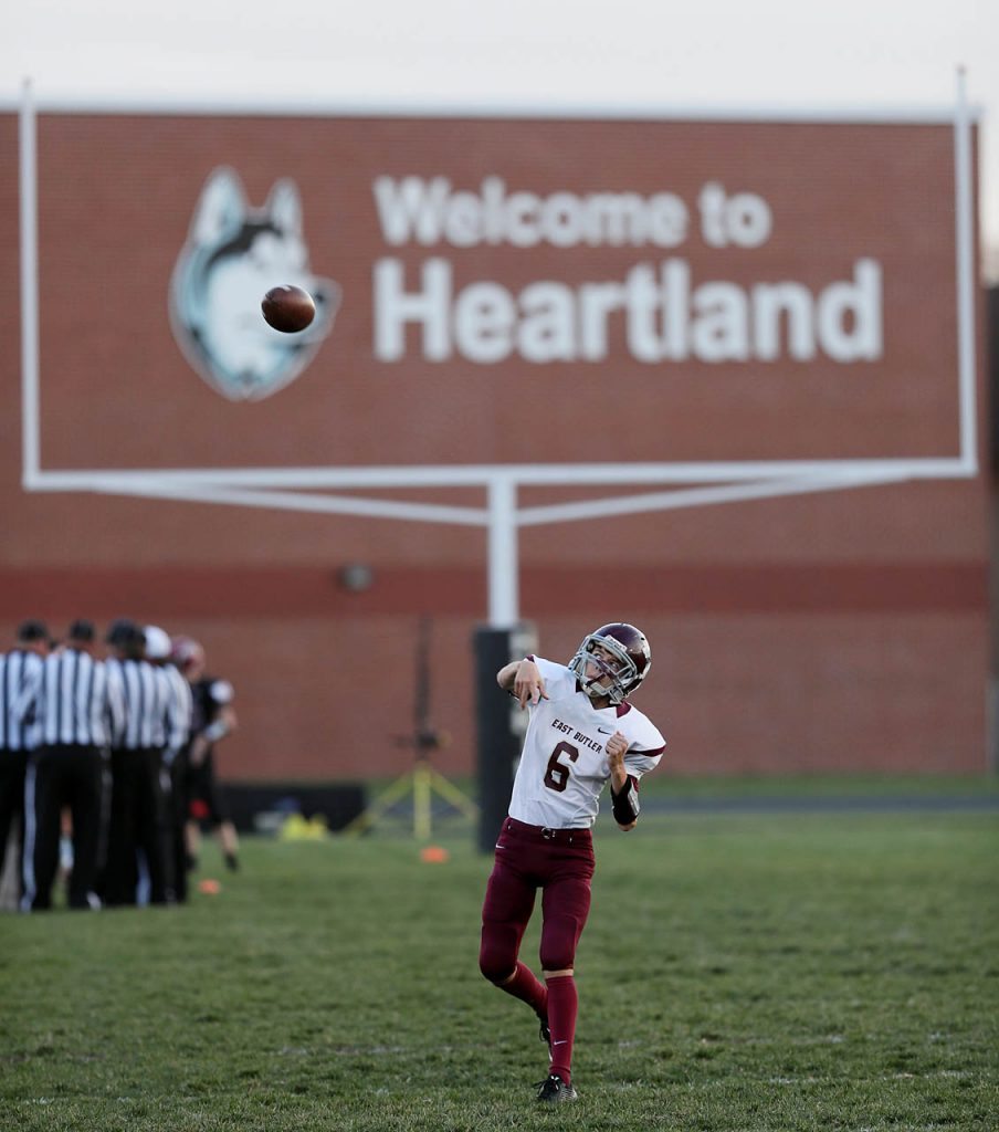East Butler freshman quarterback throws the ball while warming up prior to kickoff against Heartland.