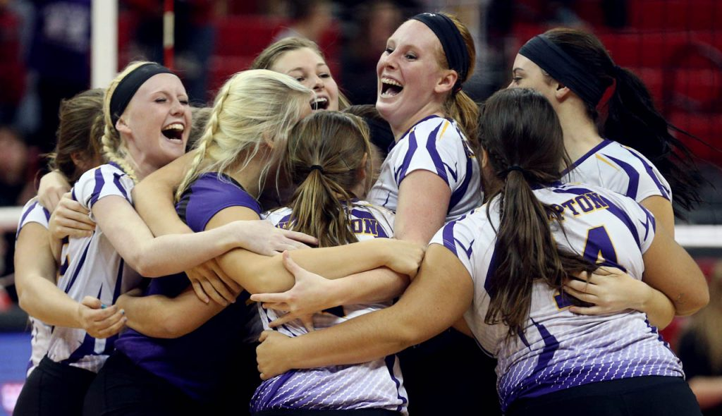 Hampton celebrates their three straight set victory over WYNOT to capture the Class D2 2016 NSAA State Volleyball Championship at the Devaney Sports Center.