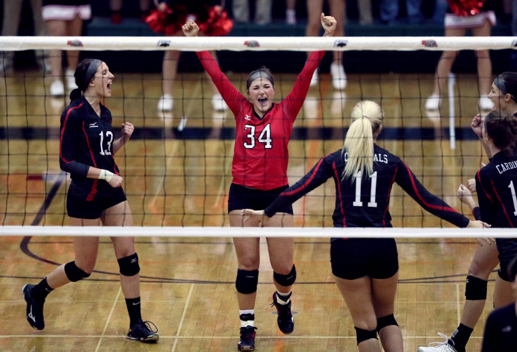 Doniphan-Trumbull celebrates a point against Southern Valley during round one of the 2016 NSAA State Volleyball Championships at Lincoln Southwest High School.