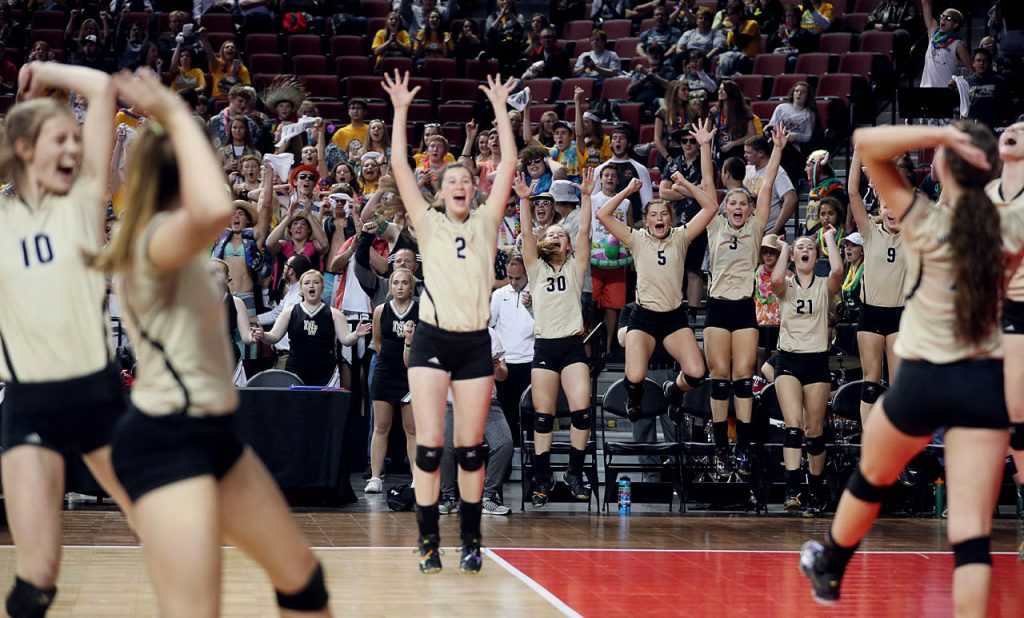 The Northwest Lady Vikings celebrate a point against Gretna during round two of the Class B 2016 NSAA State Volleyball Championships at the Pinnacle Bank Arena.
