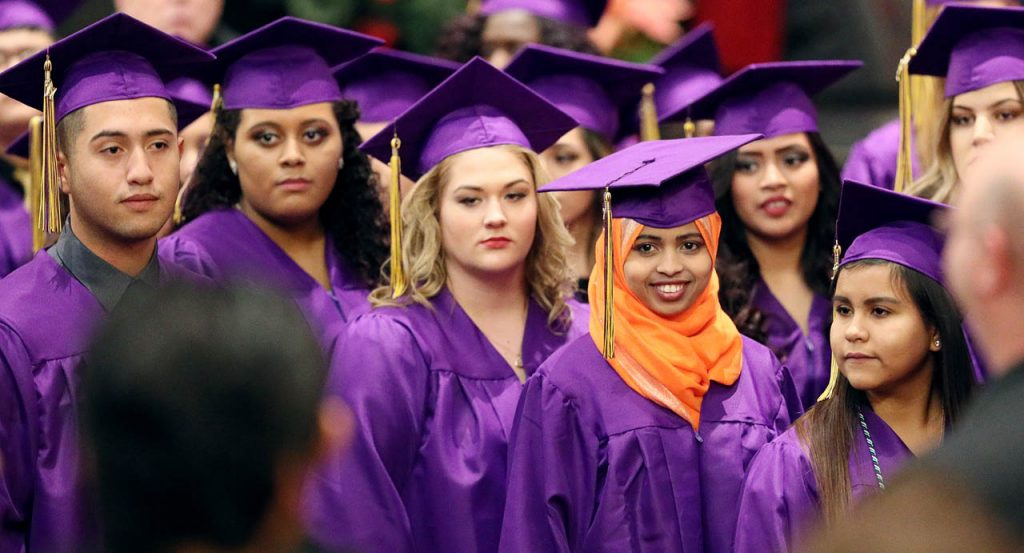 Igra Mohamed smiles while watching her fellow classmates in the processional during the Grand Island High School Class of 2017 mid-term commencement exercises Tuesday. (Independent/Andrew Carpenean)