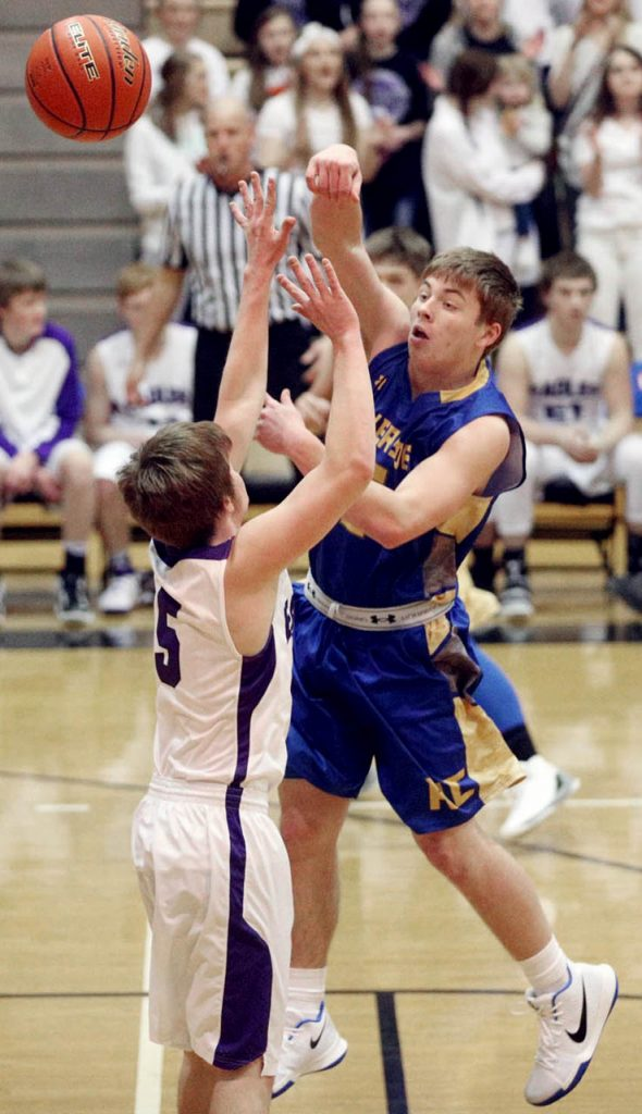 Riverside guard Tredyn Prososki passes the ball to the outside against Garden County during the Nebraska Sate Boys Basketball Championships at Lincoln Southeast High School Thursday. Riverside won 70-27.
