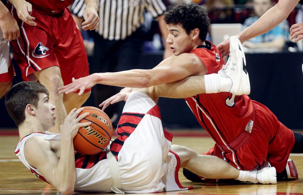 Scottsbluff's Gabriel Patton, left, battles for possession of the ball with Aurora's Thomas Leininger during the Nebraska State Boys Basketball Championships at the Pinnacle Bank Arena Friday. Scottsbluff won 76-67.
