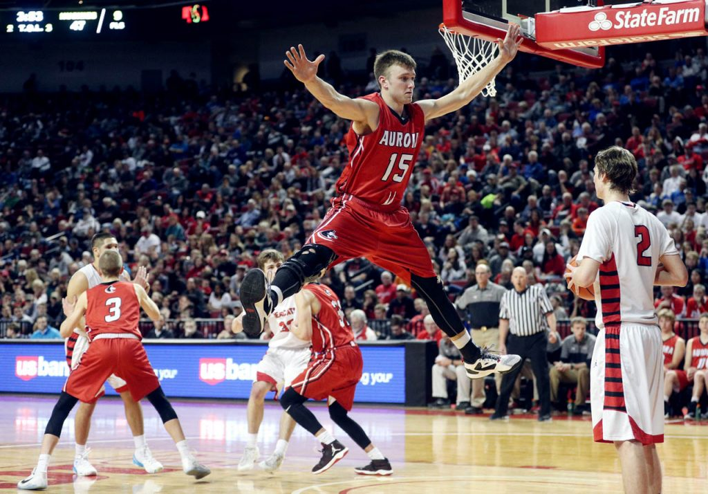 Aurora's Austin Allen jumps in the air as Scottsbluff's Evan Hughes looks to inbound the ball during the Nebraska State Boys Basketball Championships at the Pinnacle Bank Arena Friday. Scottsbluff won 76-67.