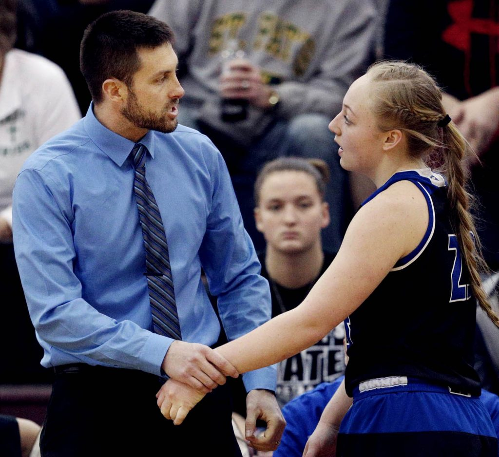 Ravenna head coach Noah Maulsby has a talk with McKenna Schmidt as she comes out of the game against North Platte during round one of the Nebraska State Girls Championships at Lincoln North Star High School Thursday. Ravenna won 57-49.