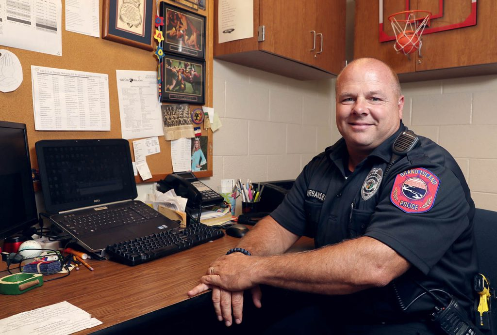 Grand Island Police officer Jason Urbanski inside his office at Barr Middle School. Urbanski has been a school resource officer at Barr for over 12 years.