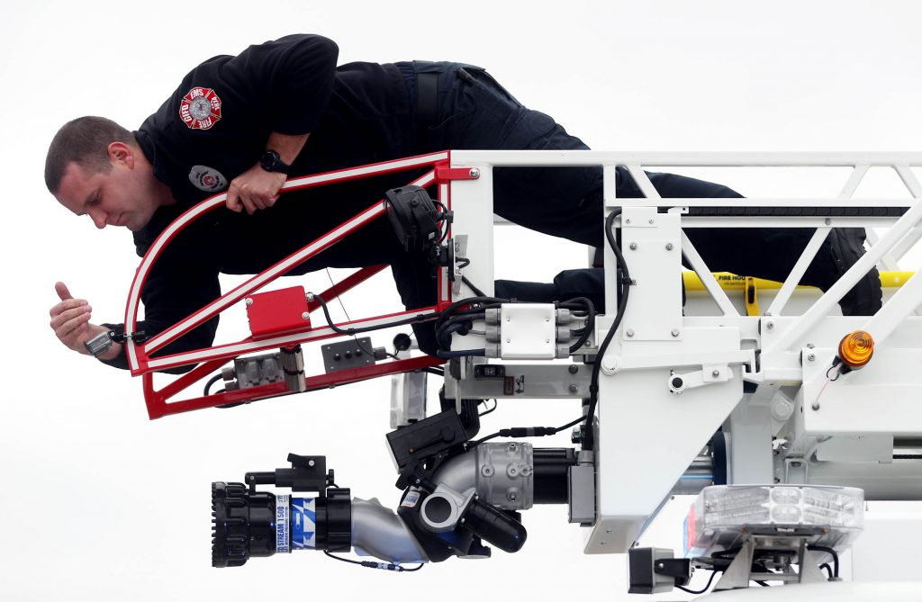 Grand Island firefighter Tony Grabenstein looks at a GoPro camera he placed for a news station on the top of a 75-foot ladder quint truck at Station 1 Thursday.