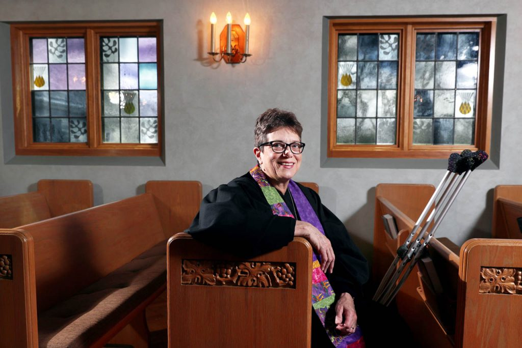 Rev. Caroline Price-Gibson sits in a pew inside the First Presbyterian Church chapel.