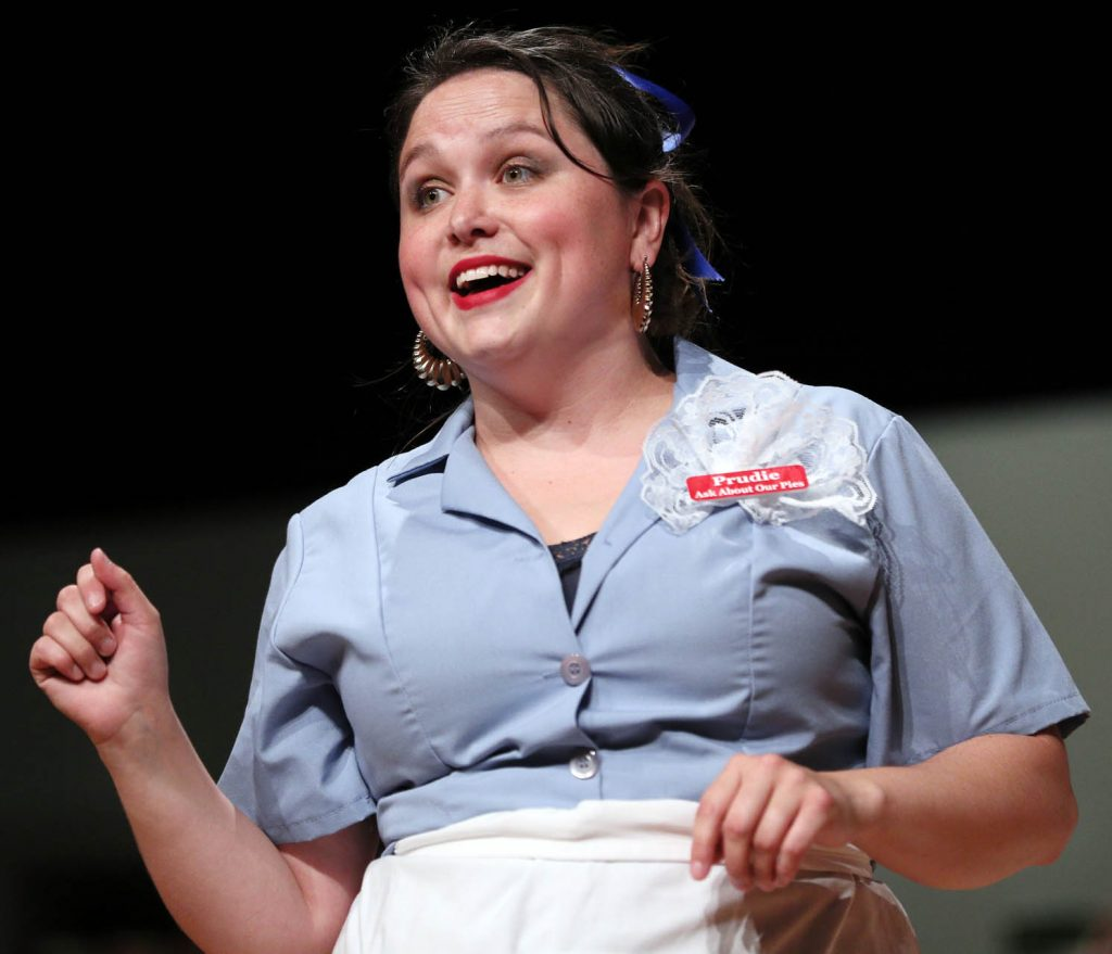 A newcomer to Grand Island Little Theatre, Kelsey Helget, plays the role of Prudie Cupp during Pump Boys and Dinettes.