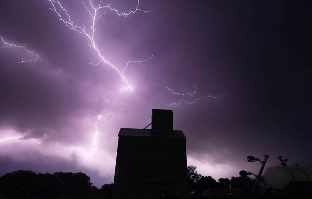 Lightning strikes above Agricultural Services Inc. in Doniphan Tuesday night as a string of severe thunderstorm storm cells moved throughout the region.
