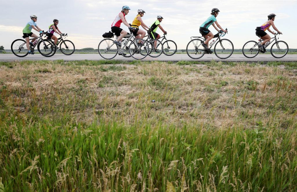 Cyclists head out on Hwy. 281 to start their ride during the 2017 Tour de Nebraska Wednesday at the Howard County Fairgrounds.