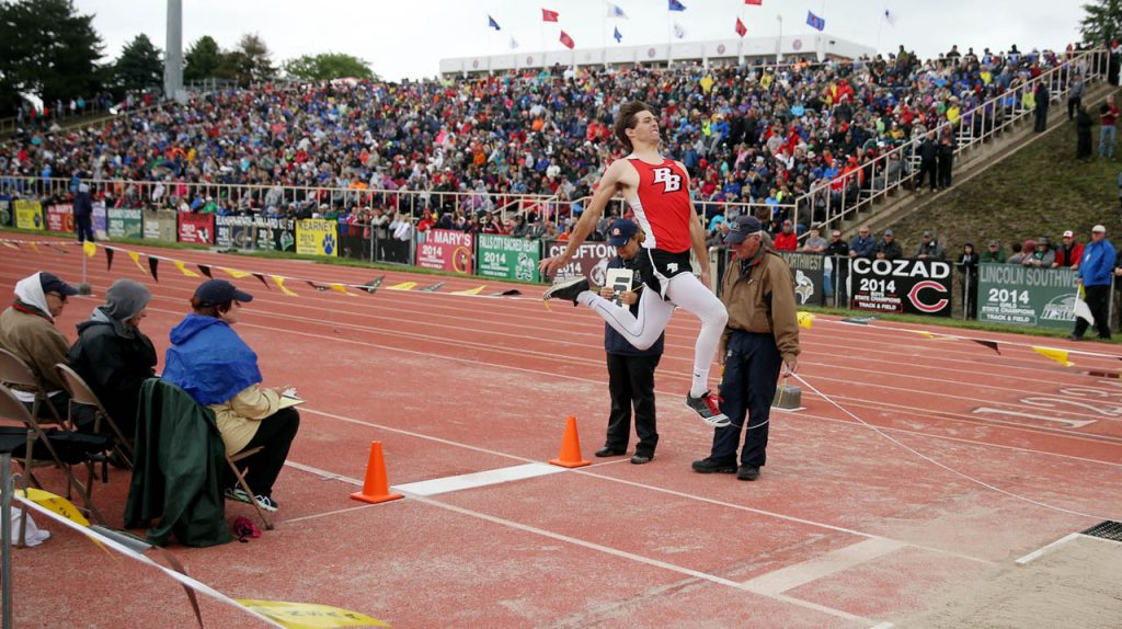 Broken Bow's Dylan Reynolds soars through the air while competing in the last flight of the boy's Class B long jump during the Nebraska State Track & Field Meet at Omaha Burke Stadium.
