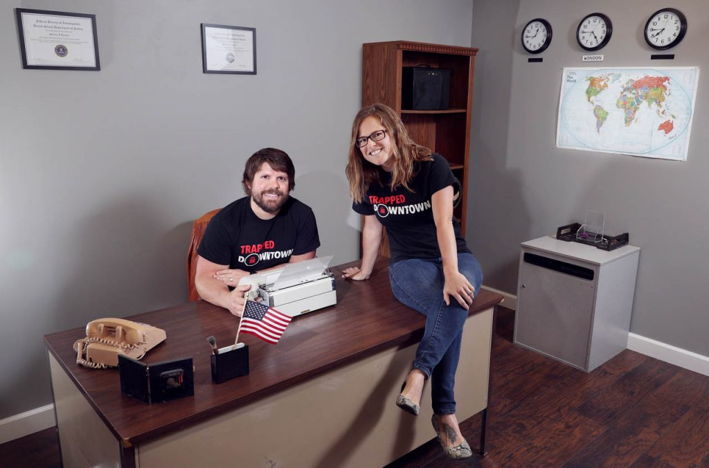 Andrew and Courtney McCarty are a married couple that are owners of Trapped Downtown where they pose inside one of two escape rooms named The Office. Their business is located at 229 N. St. Joseph St. in Hastings.