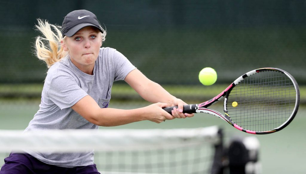 Grand Island's Morgan Eihusen charges toward the net during a Class A number two doubles match against Millard South during the 2017 Girl's State Tennis Tournament at Koch Tennis Center Thursday.