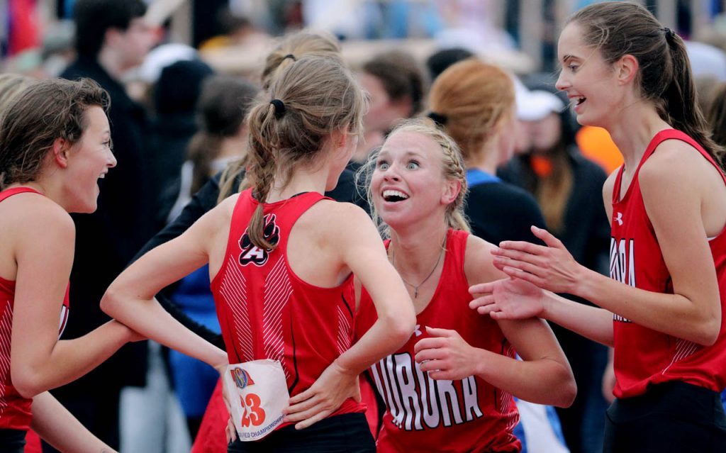 Adyson Narber of Aurora looks wide eyed at Jonna Bart after she edged out Plattsmouth to win the Class B girl's 3,200-meter relay during the second session of the Nebraska State Track & Field Meet at Omaha Burke Stadium.