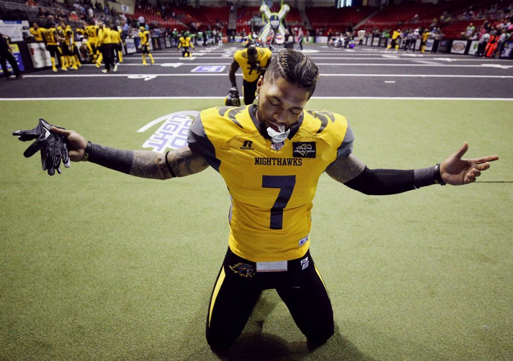 Wichita Falls Nighthawks wide receiver Troy Evans Jr. prays on both knees in the end zone prior to kickoff in an Indoor Football League game against the Nebraska Danger.