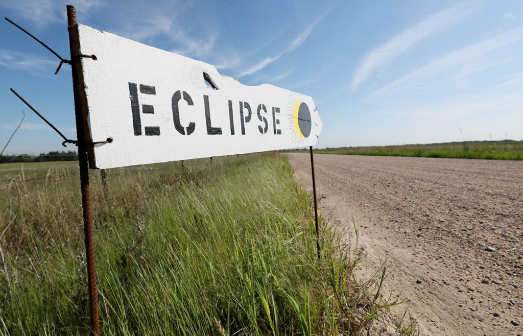 An eclipse sign leads the way to Liberty Range on Liberty Rd. in Dannebrog, Neb. Monday.