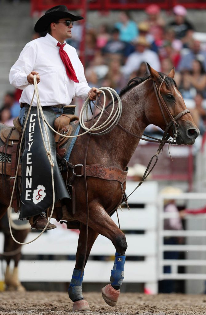 A pick-man gets into place during a Cheyenne Frontier Days rodeo.