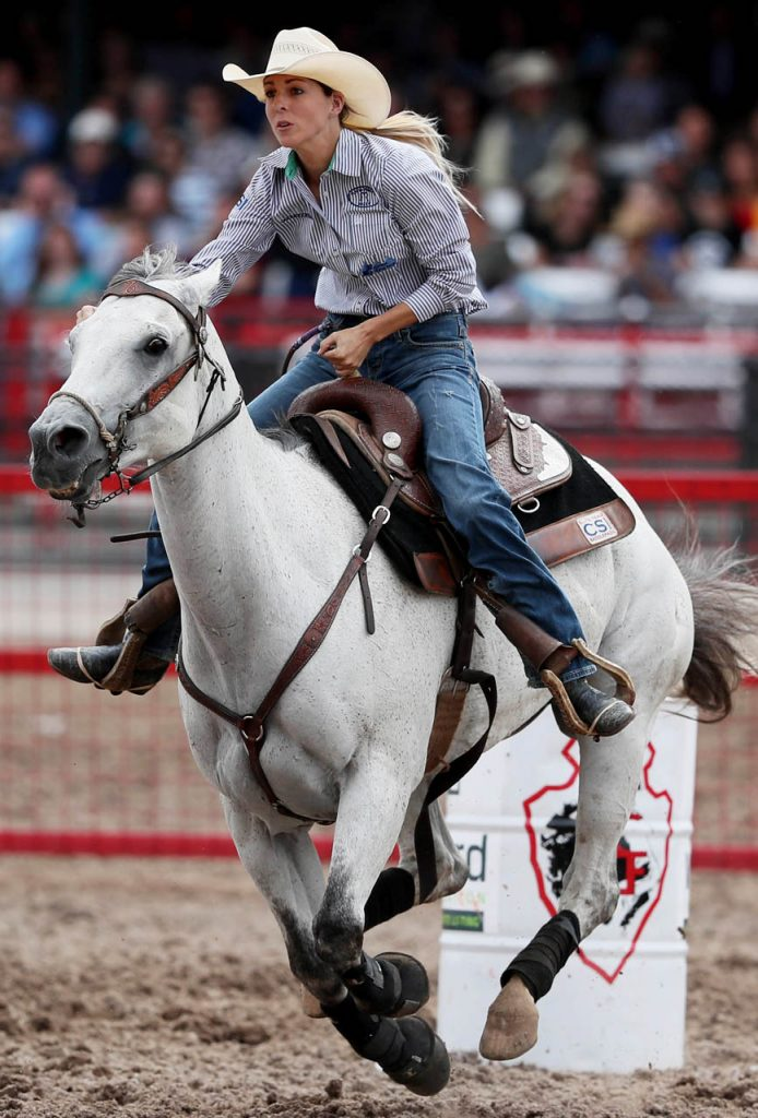Carley Richardson of Pampa, Texas competes in barrel racing at Cheyenne Frontier Days. (Photo by Andrew Carpenean)