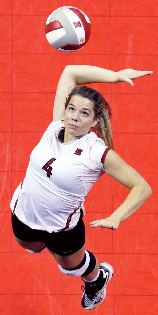 Hastings College senior Jill Bax serves against Oklahoma City during The Bill Marshall Classic on opening day of the Nebraska State Fair at the Heartland Event Center Friday.
