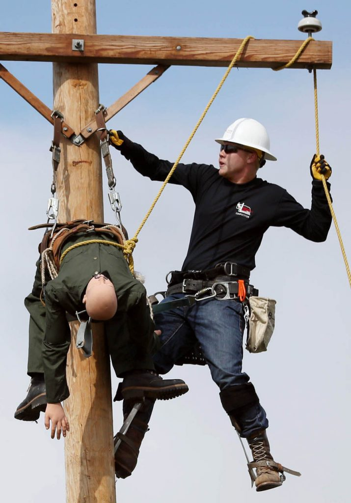 Alex Meeks gets ready to lower a mannequin while competing in the hurt man rescue during the 6th annual Nebraska Lineworkers Rodeo at the state fair Saturday.
