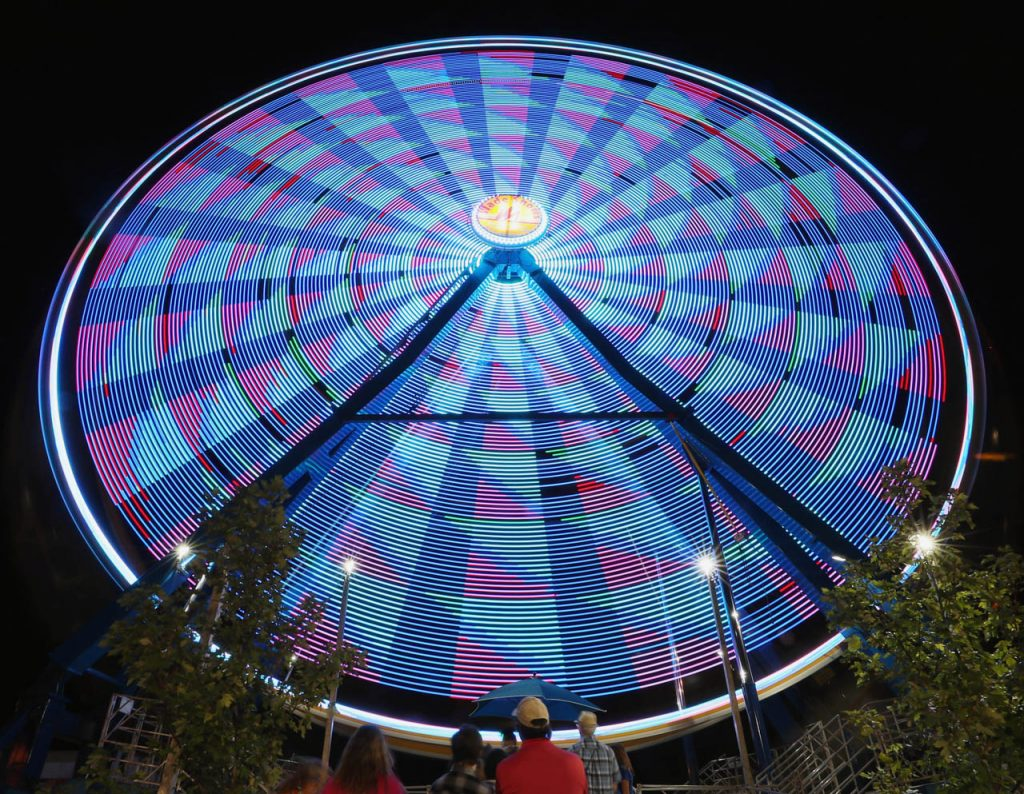 4PP: People wait in line to take a ride on the Giant Gondola Wheel on the midway during the Nebraska State Fair.