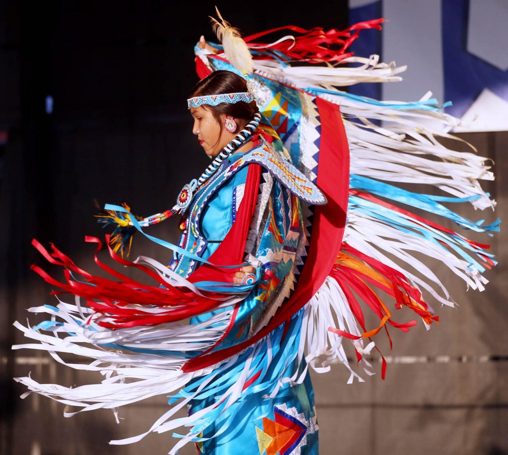 Marysa Dominquez, a Sicanju Lakota Indian from Lincoln, dances on the Family Fun Zone Stage as a member of the Many Moccasins Dance Troupe at the Nebraska State Fair Friday.