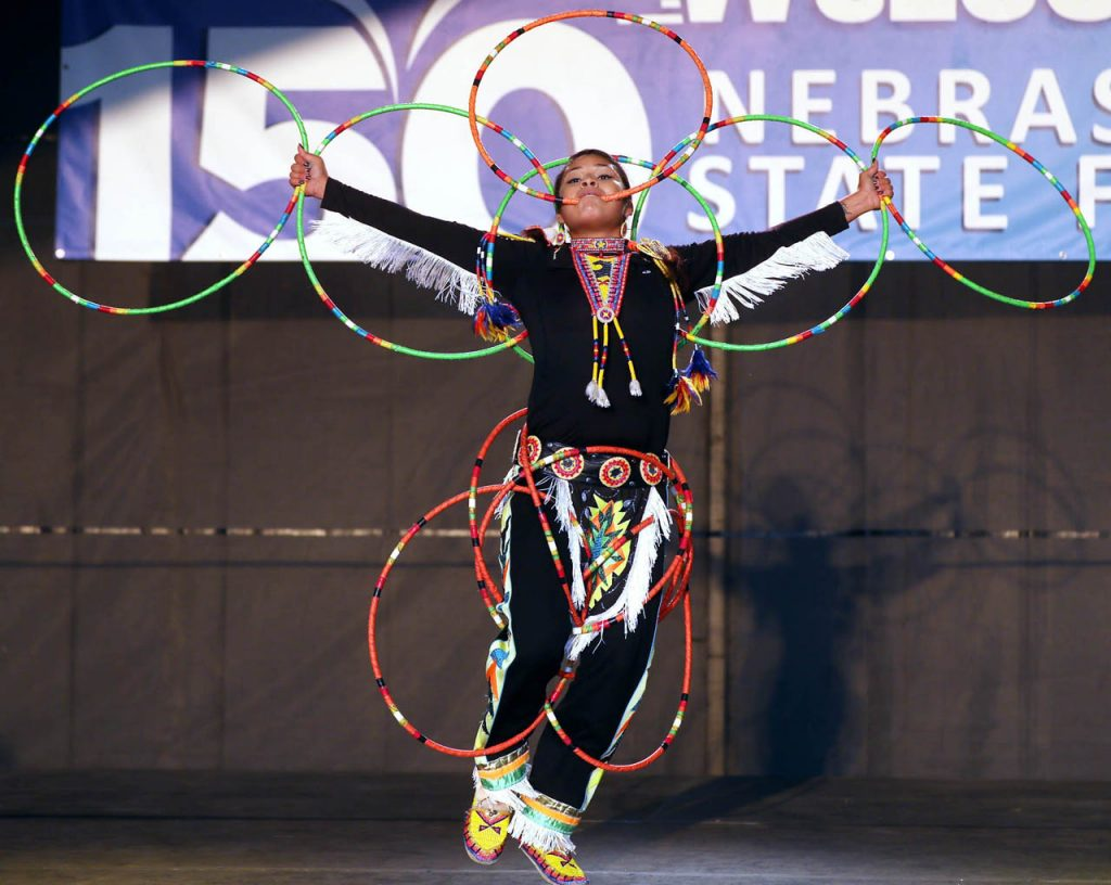 Kaarina Dominquez of Lincoln dances with multiple hoops on the Family Fun Zone Stage as a member of the Many Moccasins Dance Troupe at the Nebraska State Fair Friday.