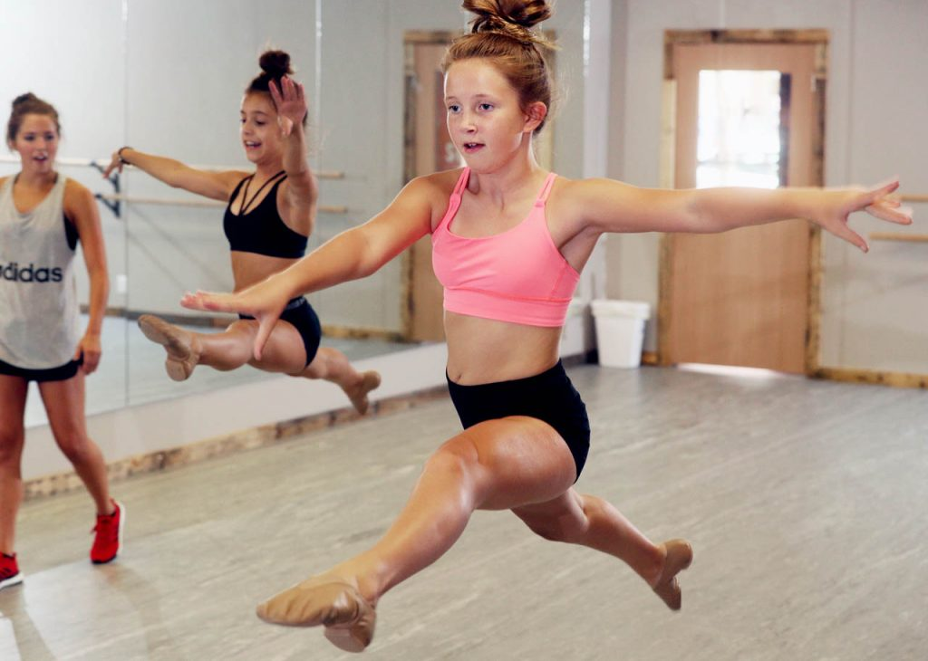 MacKenzieWiese, right jumps during a jazz dance class at Create 308.