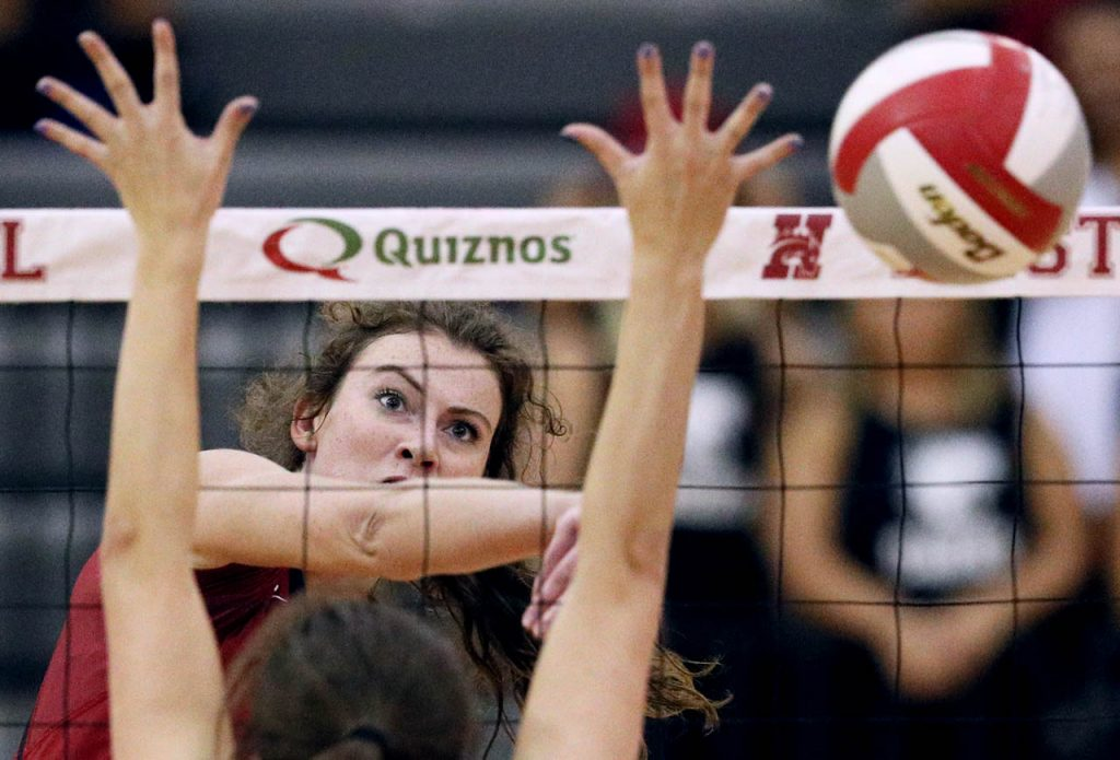 Hastings College senior middle hitter Andrea LaVene goes for a kill against St. Mary's MacKeenzie Melton (1) during the second set at Lynn Farrell Arena Wednesday night.