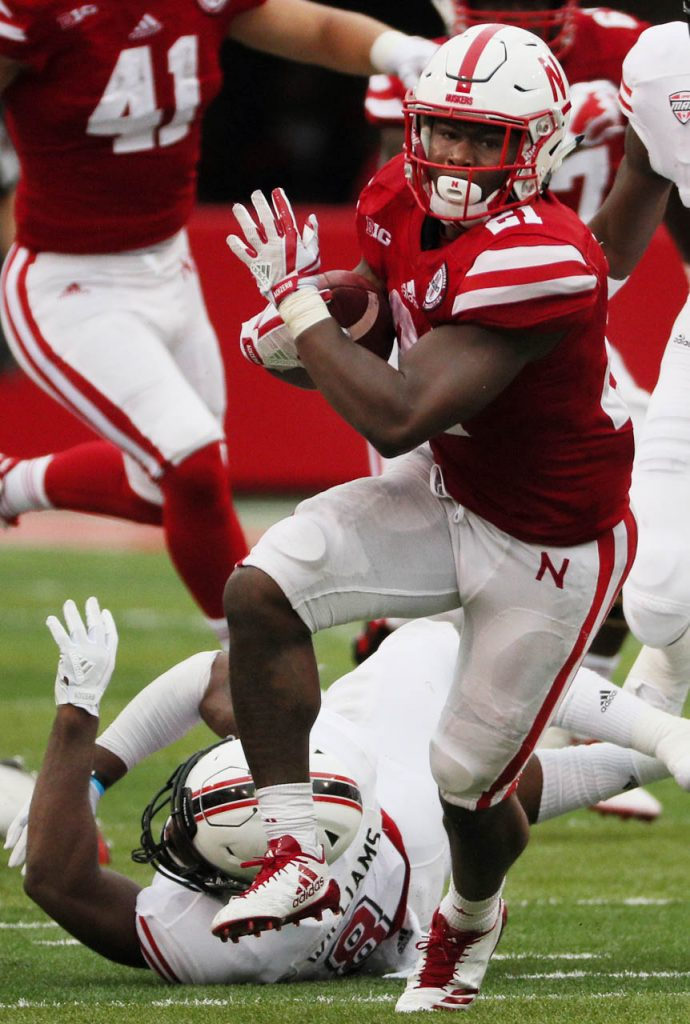 Nebraska running back Mikale Wilbon breaks a Northern Illinois tackle during first half action at Memorial Stadium.