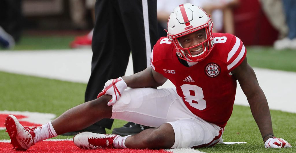 Nebraska wide receiver Stanley Morgan Jr. grimaces while holding his right knee.
