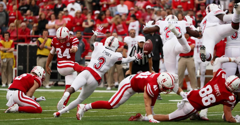 Nebraska place kicker Drew Brown has his field goal attempt blocked by Northern Illinois players.