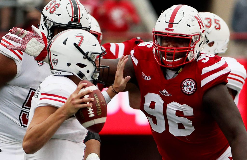 Nebraska defensive lineman Carlos Davis sacks Northern Illinois quarterback Daniel Santacaterina during second half action at Memorial Stadium.