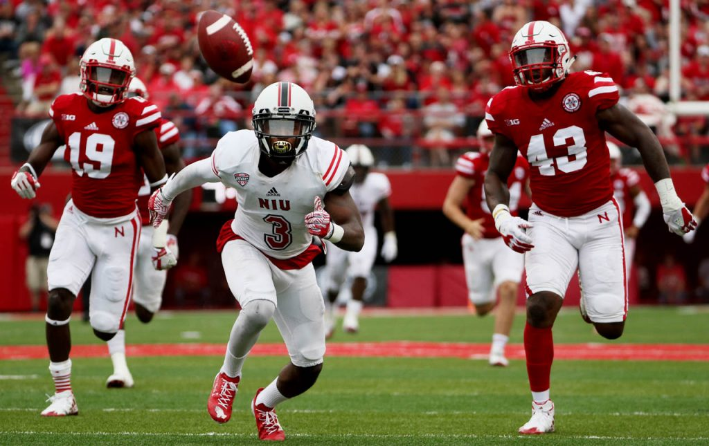 Northern Illinois punt return man Jalen Embry runs back after his fumble resulting in a turnover as Nebraska special teams players Marquel Dismuke (19) and Tyrin Ferguson (43) are close by at Memorial Stadium Saturday.