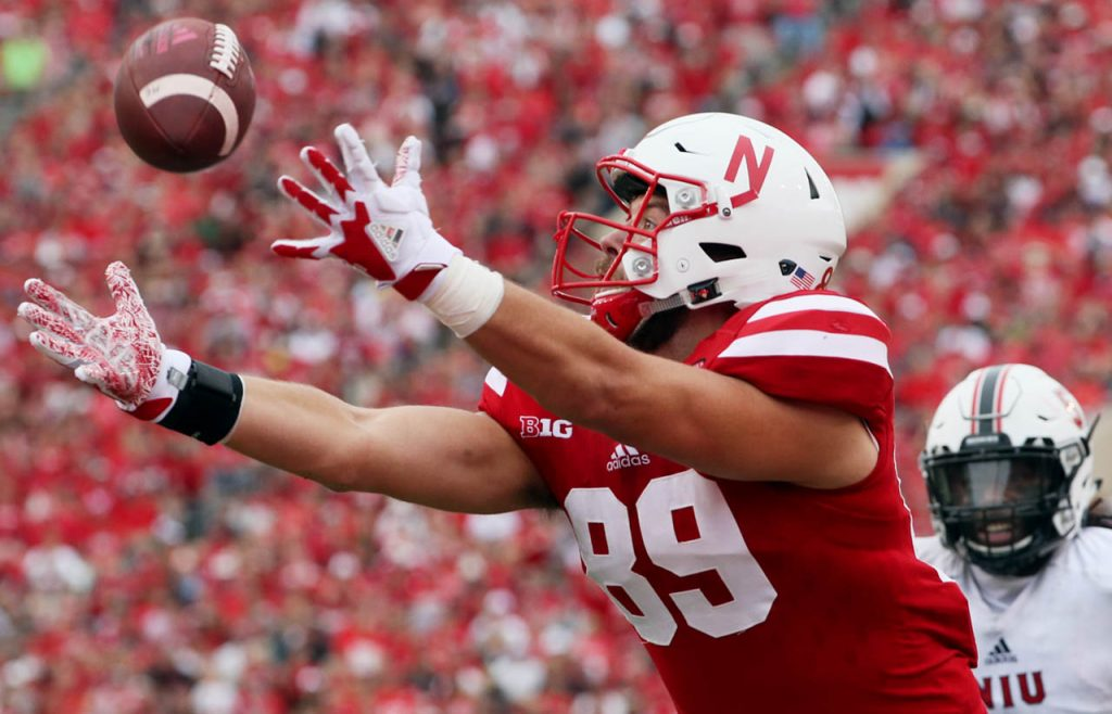 A pass from Nebraska quarterback Tanner Lee goes through the hands of tight end Connor Ketter as a Northern Illinois player trails at Memorial Stadium.