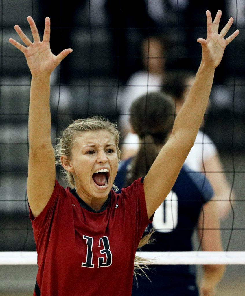 Hastings College sophomore outside hitter Cassidy Ostrand celebrates a point against St. Mary during the first set at Lynn Farrell Arena Wednesday night.