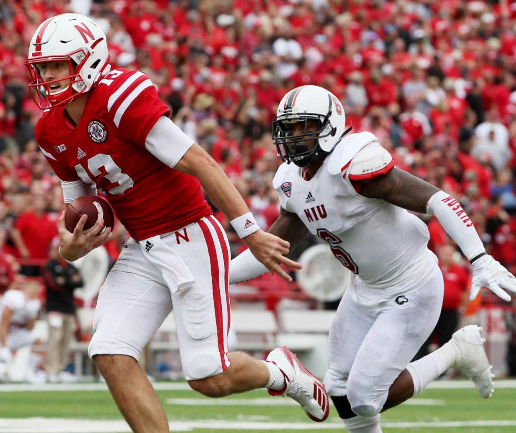 Nebraska quarterback Tanner Lee skampers into the end zone for a Huskers touchdown against Northern Illinois.