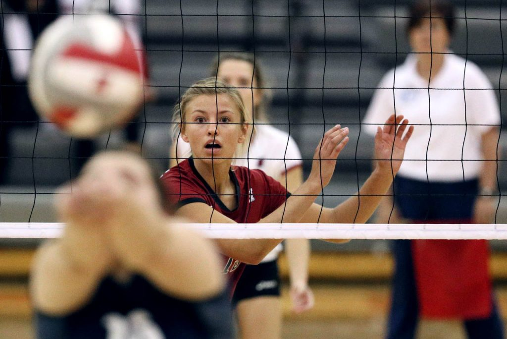 Hastings College sophomore Cassidy Ostrand watches as Allie Majerus of St. Mary bumps the ball.