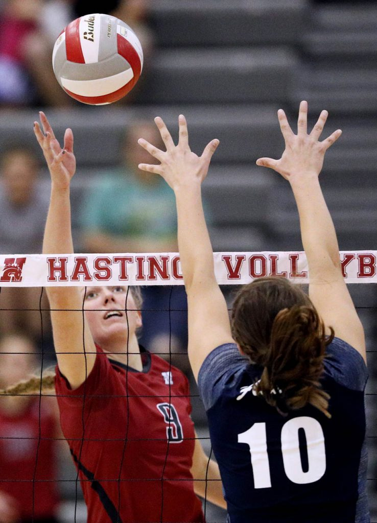 Hastings College senior setter Katie Placke tips the ball over the net against St. Mary during the second set at Lynn Farrell Arena Wednesday night.