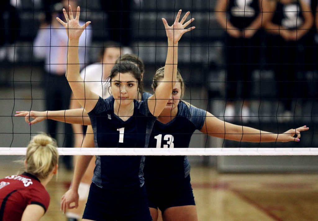 MacKenzie Melton (1) and Allie Majerus (13) takes their spots in front of the volleyball net against Hastings College at Lynn Ferrell Arena.