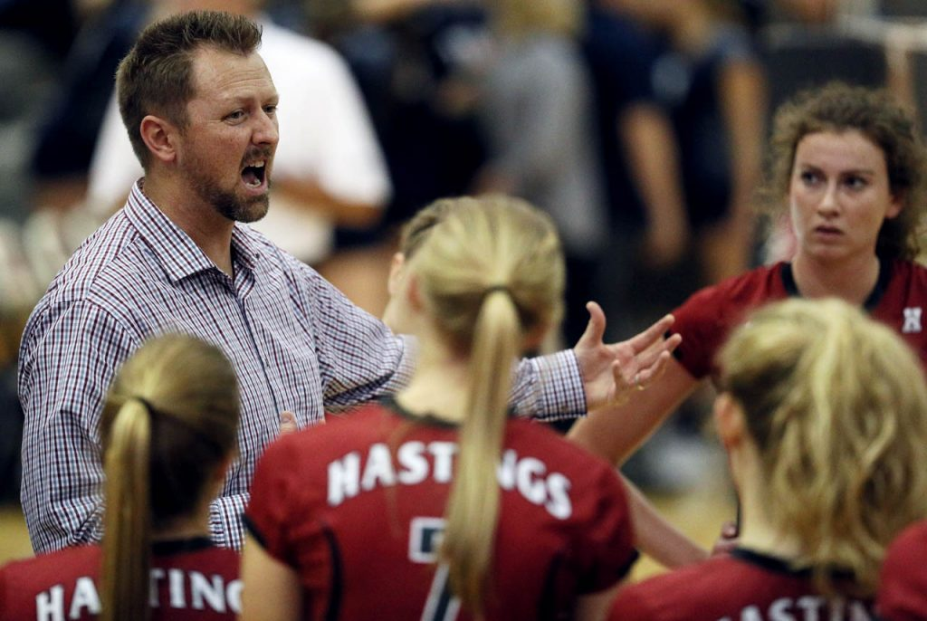 Hastings College head coach Matt Buttermore talks with his players during a timeout against St. Mary at Lynn Farrell Arena Wednesday night.
