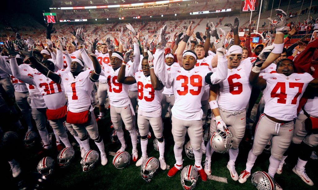 Ohio State Buckeyes players and coaches sing the Carmen Ohio Alma Mater concluding a 56-14 victory over the Nebraska Cornhuskers as half the fans made a mass exodus from Memorial Stadium in Lincoln. (Independent/Andrew Carpenean)