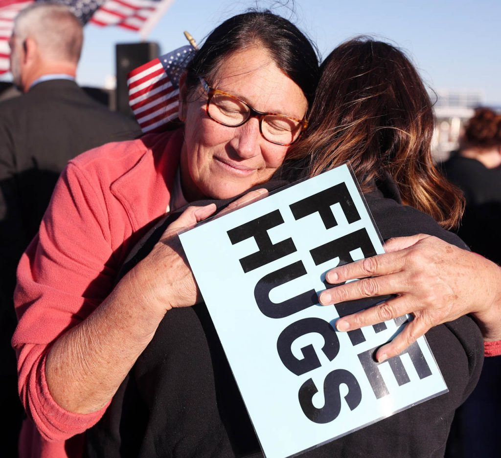 Nita Lechner of Grand Island gives free hugs to those attending a Hero Flight Welcome Home Wednesday at the Central Nebraska Regional Airport. Lechner has done this in 26 states including coming back from a recent trip to Washington D.C. and seven east coast states.