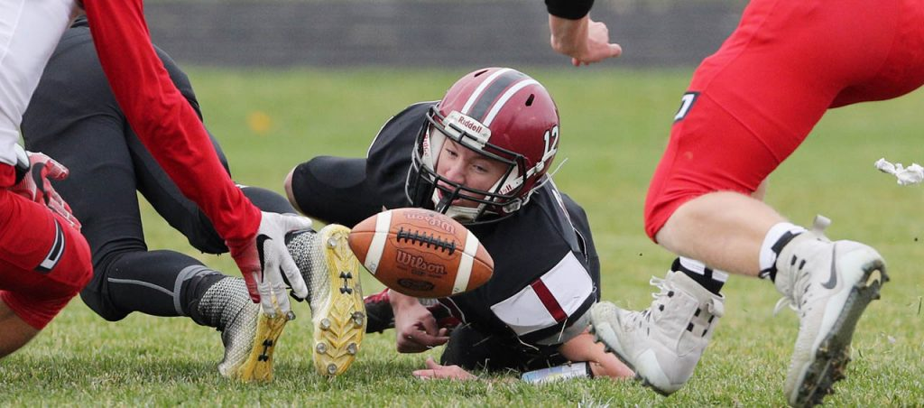 The ball springs free from Heartland's Hayes Oswald resulting in a turnover to Johnson-Brock during an 8-man playoff football game in Henderson Thursday.