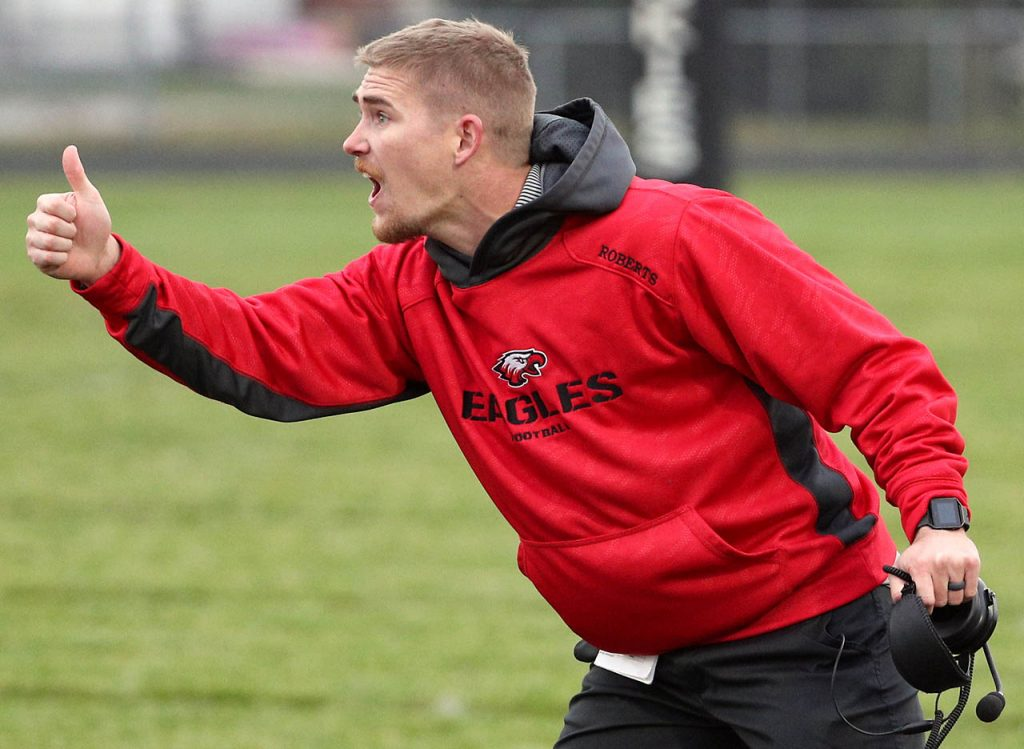 Johnson-Brock head coach Mitch Roberts gives a thumbs up to his players from the sidelines while playing Heartland Thursday in Henderson.