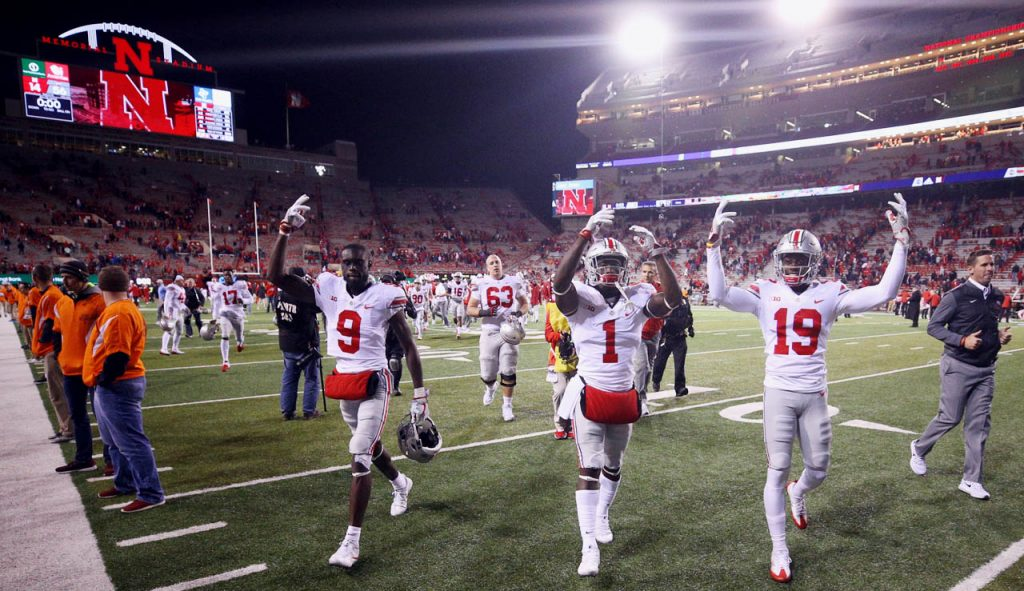 Ohio State Buckeyes teammates Binjimen Victor (9) Johnnie Dixon (1) and Elijaah Goins get cheers from their fans traveling on an away game against Nebraska in Lincoln. The Buckeyes beat the Cornhuskers 56-14. (Independent/Andrew Carpenean)