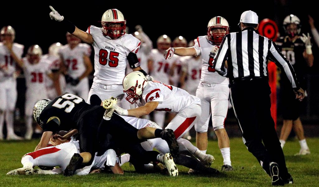 Aurora senior Ian Boerkircher (85) signifies a Huskies possession on a Northwest fumble at Viking Field Friday night.